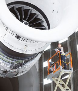 Careers-Jet-Engine-female-on-cherry-picker-next-to-it-with-hard-hat-etc