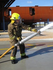 Kristin Fire Fighter Action with hose single shot