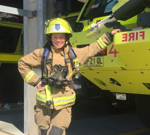 Kristin-Fire-Fighter-full-gear-next-to-truck-(1)
