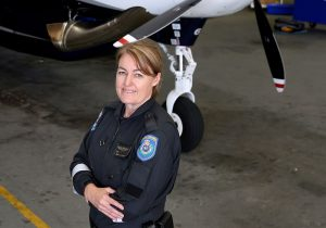 POLAIR-Salli-Ann-Standing-in-front-or-Aircraft