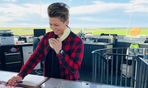 Women-In-aviation-ATC-Radio-standing-up-looking-down