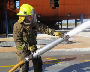 Women-in-Aviation-Kristin-Fire-Fighter-Action-with-hose-single-shot