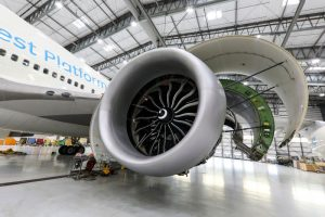 Women-in-aviation-GE9X_FTO-Engine-in-hangar-open-for-inspection